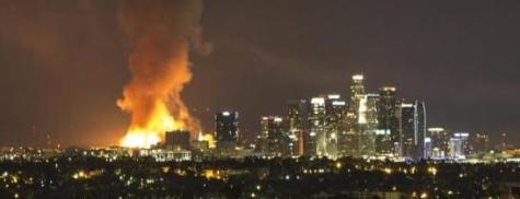 Raging LA fires burn apartment complex
