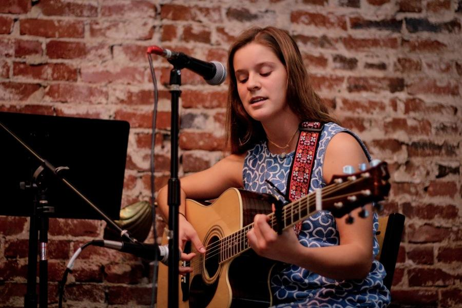 Sophomore Audrey Vernier performs an original song at the Open Mic at Kettle Coffe & Tea in Escondido. Many students came that day to hang out and listen to songs and poetry.