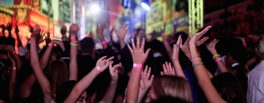 Hundreds of teenagers raise their hands in the air and dance to the latest pop songs. With the goal of preventing inappropriate dancing, a new wristband rule was enforced this year.