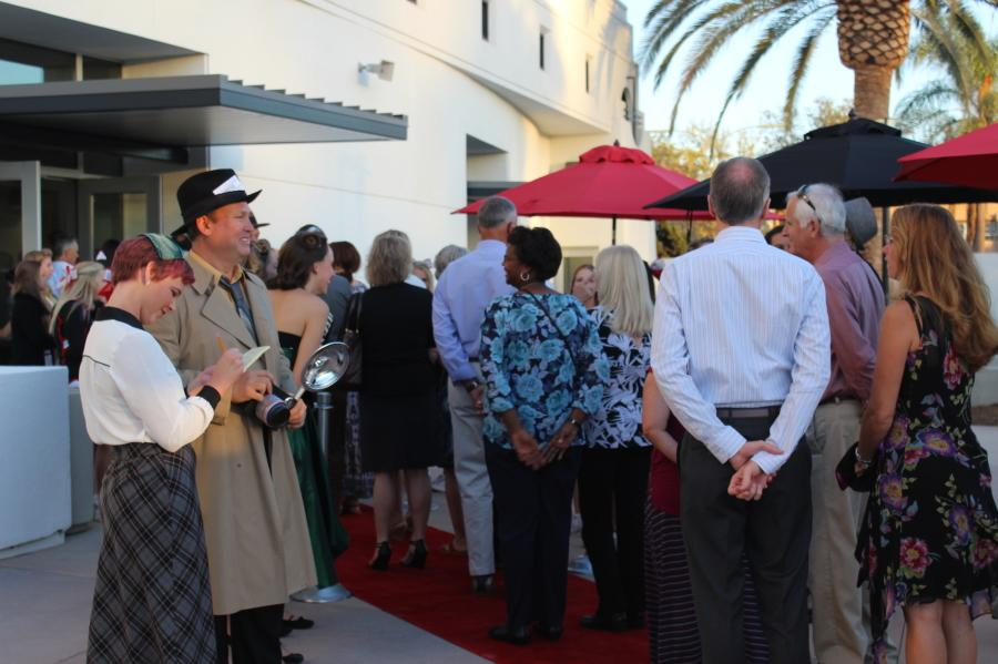 """Students and faculty put on a welcoming, antique atmosphere for guests as they enter the new campus. The greeters went out of their way to make the attendees feel part of an exclusive red carpet event while keeping a """"retro"""" feel with the evening. Photo taken by Matthew Roberts"""