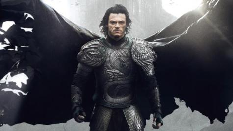 Dracula stands on a battlefield, his cape unfurling behind him as it turns into bats.