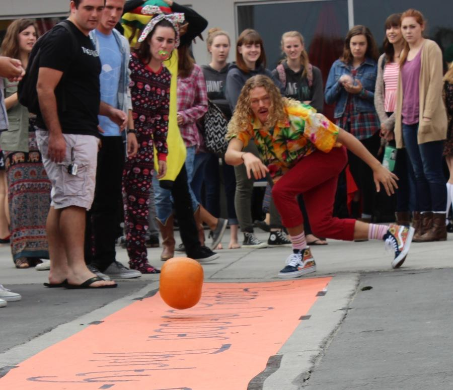 Christian Winters strikes a pose as he rolls a pumpkin down the bowling alley dressed as