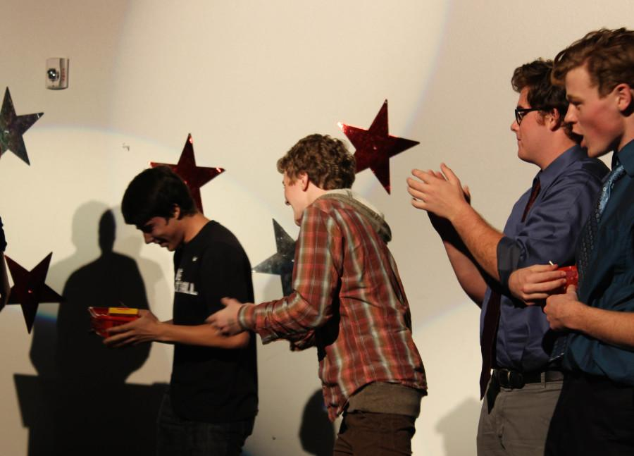Fellow film directors clap as Isaac Brown wins the award for directing the Best Comedy. Photo taken by Ethan Shicks.