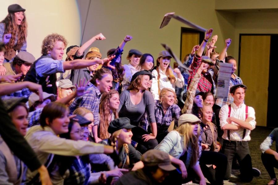 """The Caiman Crescendos pose at the end of """"Seize the Day."""" Chase McCarthy directed the choreography for the choir. Photo taken by Michaela Sanderson."""