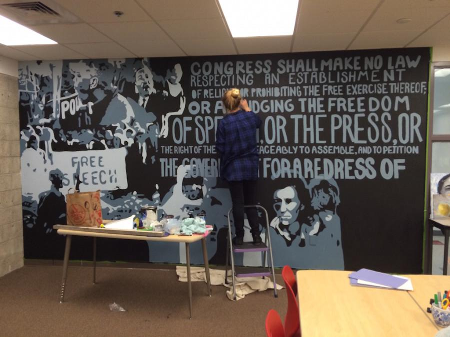 Rogers puts the finishing touches on her mural. She plans on completing the wall by June 5.