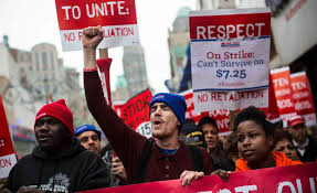 Low income workers take to the streets to protest their low wages (pbs.org).