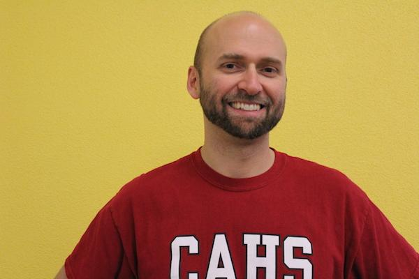 Mr. Sheffield, one of Classicals new teachers, poses for the camera in his classroom.