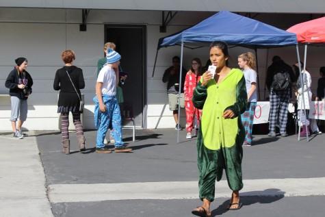 Cambria Osborn shows her school spirit by wearing a dinosaur onesie for Pajama Day.