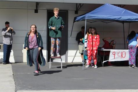 Sam Schuhler, leading the lunch time scavenger hunt game, crowns fellow senior Julia Senkbeil the winner of that round on Pajama Day.