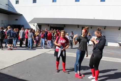 Seniors Abigail Pillsbury, Lauren Pressley and Michelle Carter represent their class with their black and red clothing.