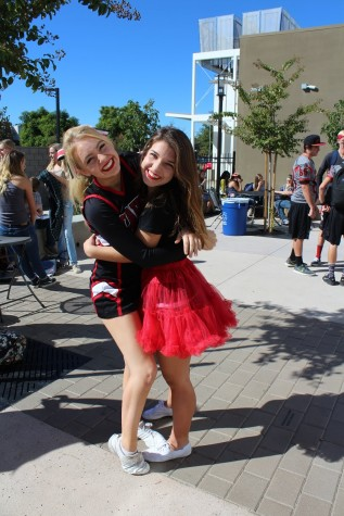 Sophomores Lauren Seyb and Lydia Brittain pose for the camera to show off their school spirit.