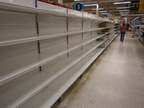 Empty shelves in stores serve as a reminder of the economic crisis in Venezuela, which has resulted in food shortages. Image courtesy of Wikimedia Commons.