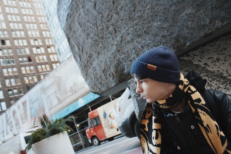 Nick Lux sits by a boulder in New York, hopeful for the future.