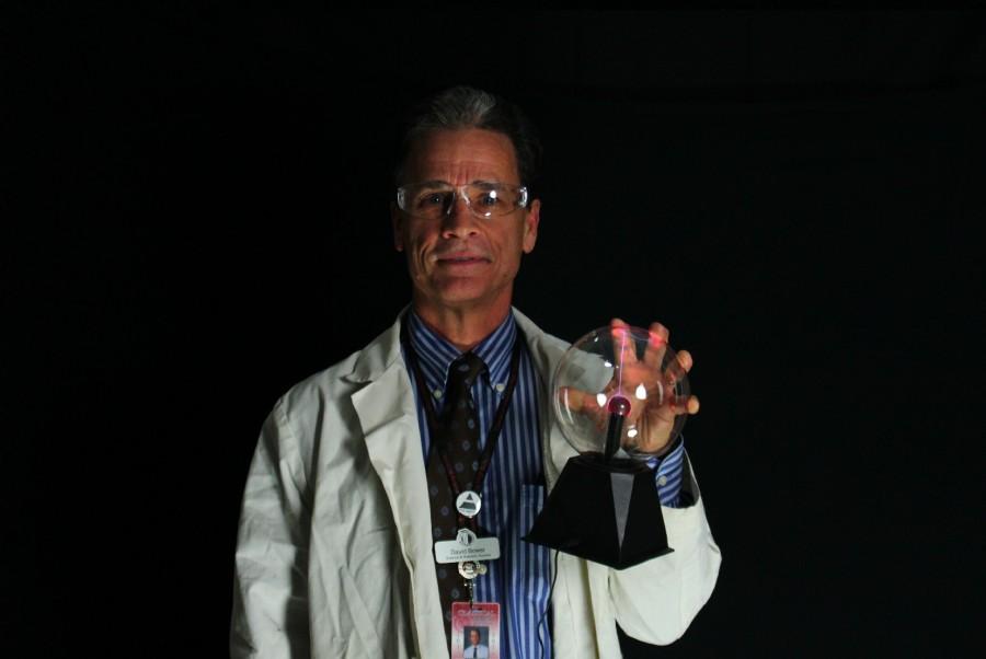 Mr. Bower shows off his plasma globe.