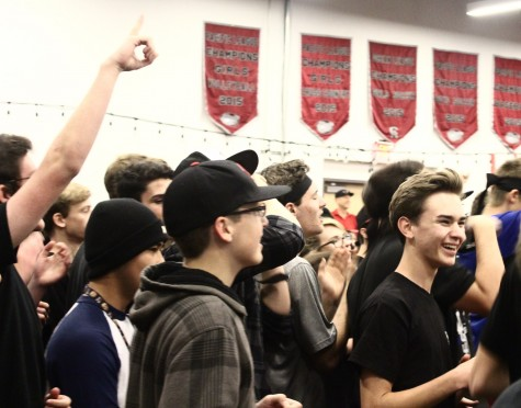 Members of Black Team rejoice after their team's victory in Family Feud