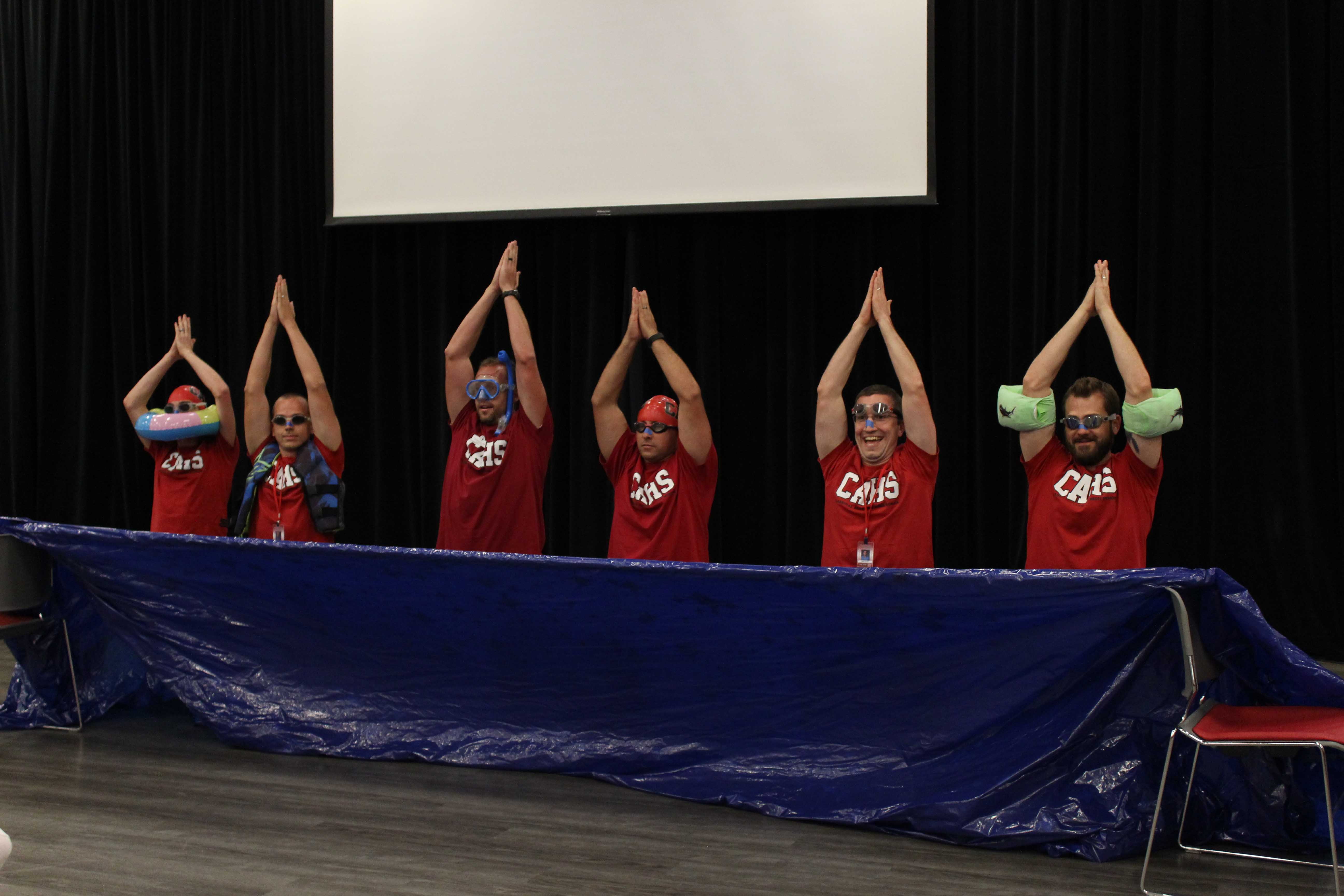 Some+of+the+male+teachers+perform+a+synchronized+swimming+routine.+Photos+taken+by+Crystal+Sung.+