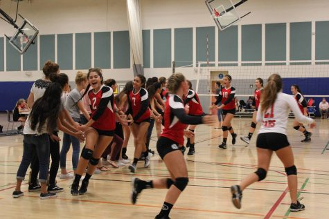 The girls celebrate their win after they won their third match. Photo taken by Skylar Todd.