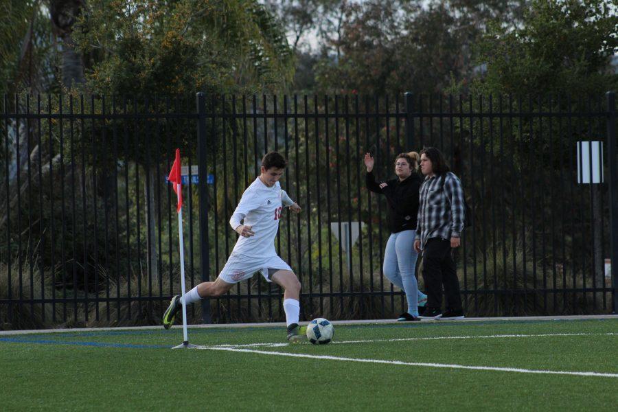 Junior JK Haman takes the corner kick during the Boys Varsity Soccer game against Del Lago.
