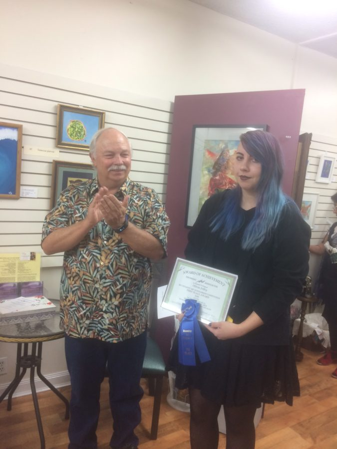 Senior Olivia Jolley was recently recognized for her pieces of art at a local showcase. Photo provided by Olivia Jolley.