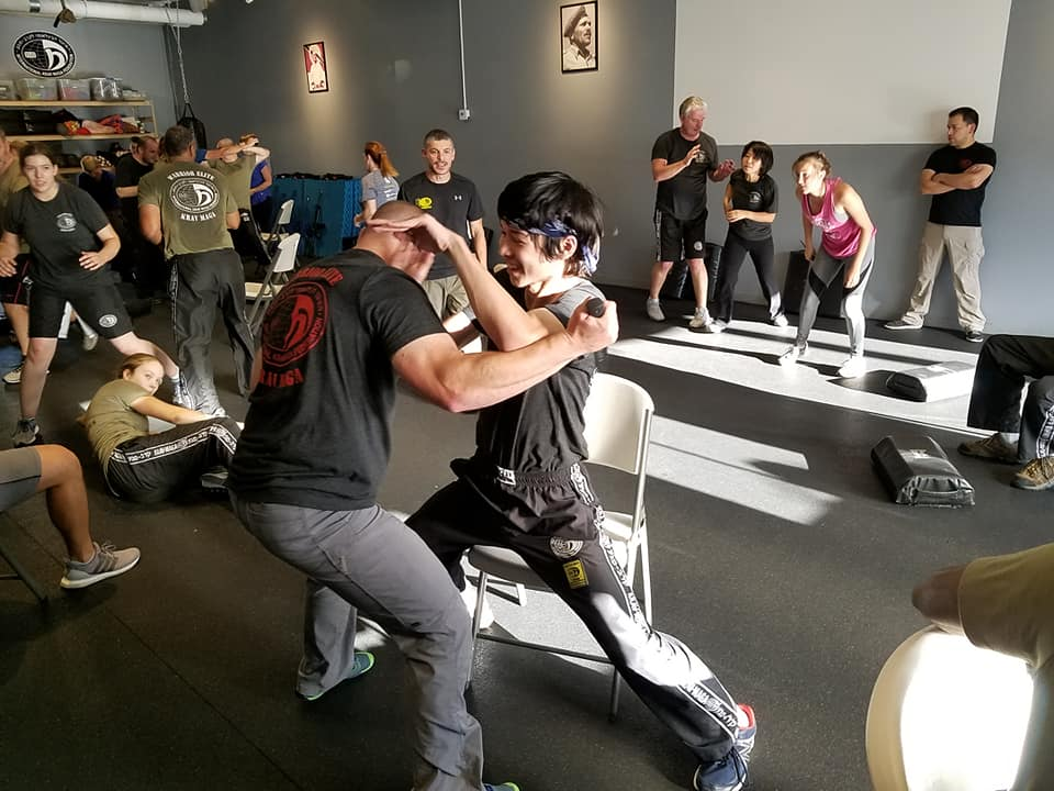 Choy grapples with a partner at his krav gym.